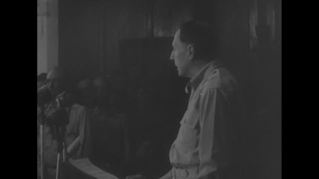 Side shot US General Douglas MacArthur continues reading his speech at Malacanang Palace ceremony at which he turns over the Filipino government to...