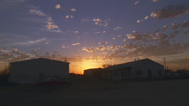 side pov small town at sunrise / odessa, texas - side view stock videos & royalty-free footage
