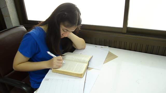 side speed view Thai woman suddenly screen a book