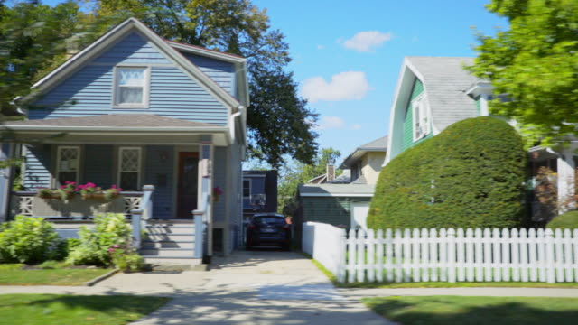 side pov suburban neighborhood homes - illinois stock-videos und b-roll-filmmaterial