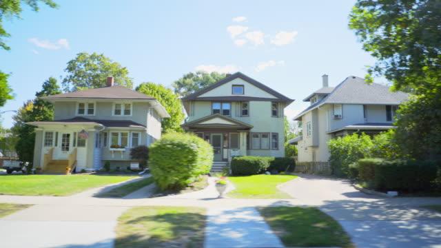 Side POV Suburban Neighborhood Homes