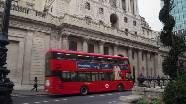 Side tracking shot across the exterior of the Bank of England building on Threadneedle Street, London.