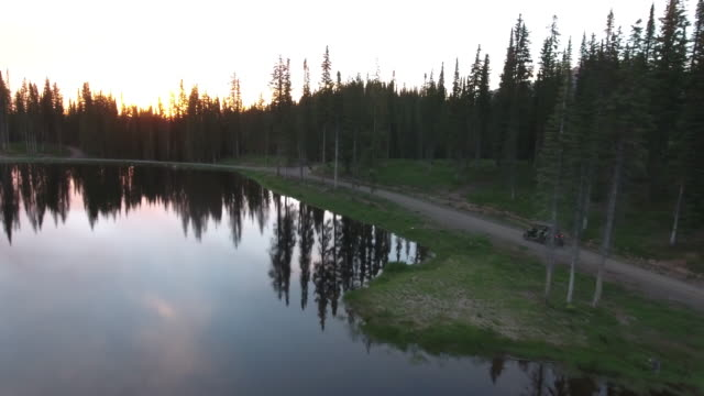 RZR side tracking SUN reveal, Rocky Mountains Reveal Fall colors Lake Reflection, Off road, rzr Wildlife, Foliage SHORT Aerial, 4K, 17s, 67of102, Stock Video Sale - Drone Discoveries - Drone Aerial view