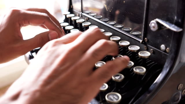 side view: asian's hands use retro typewriter that is german keyboard - typewriter keyboard stock videos & royalty-free footage