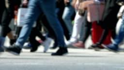 Side view blurry pedestrians walking.