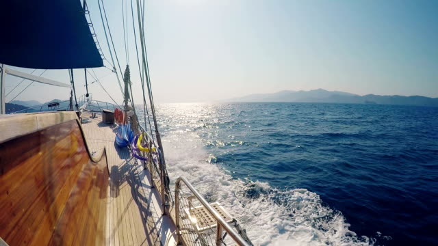 Side view from a yacht cruising mediterranean costs (boat point of view)