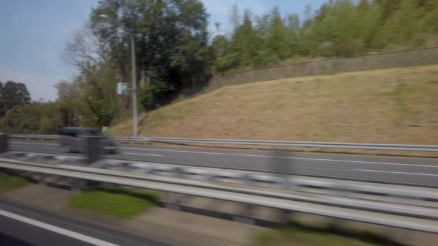 4k side view from bus - moving past stock videos & royalty-free footage