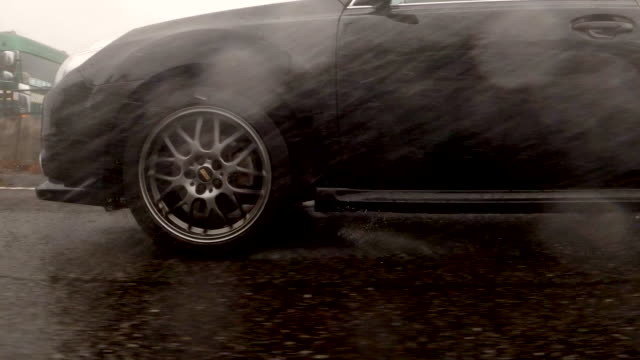 side view from car / rainstorm / slow motion /driving studio process plate - slippery stock videos & royalty-free footage