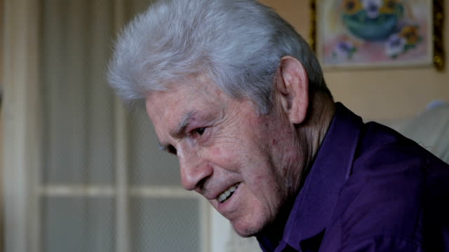 Side view headshot of a senior adult man