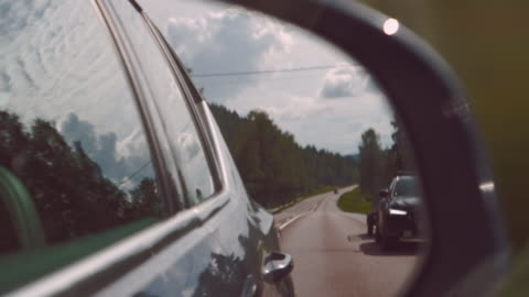 side view mirror road marks and tar road with overtaking car - car stock videos & royalty-free footage