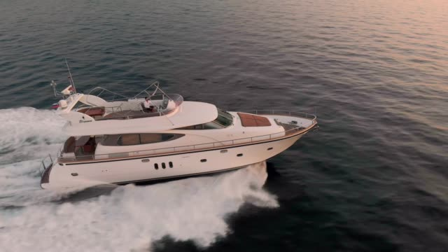 side view of a luxory yacht out at sea - yacht stock videos & royalty-free footage