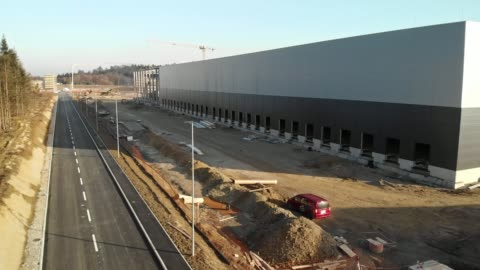 side view of a storage facility construction site - crane construction machinery stock videos & royalty-free footage