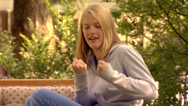side view of blonde teen girl talking to someone standing out of shot - one teenage girl only stock videos & royalty-free footage