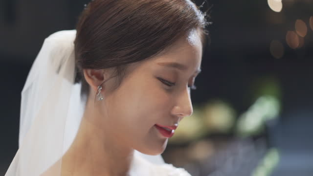 side view of bride looking at the ring from groom - human nose stock videos & royalty-free footage