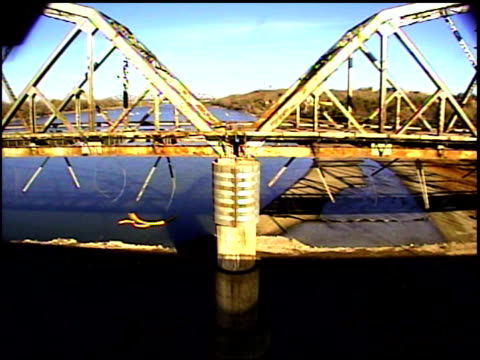 ms side view of bridge collapsing after explosives detonate / bismarck, north dakota, united states - bismarck north dakota stock videos & royalty-free footage