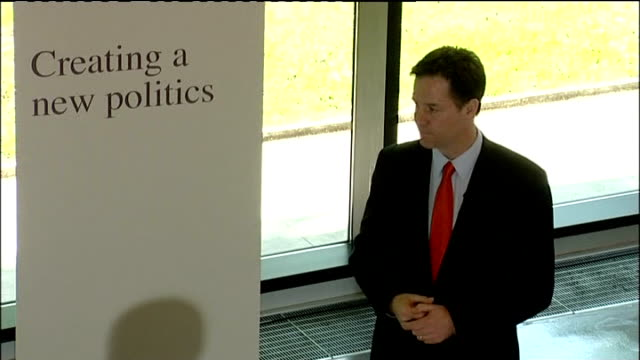 side view of clegg at podium close shot of clegg speaking high angle view of clegg speaking next to sign reading 'creating a new politics' nick clegg... - politics and government stock videos & royalty-free footage