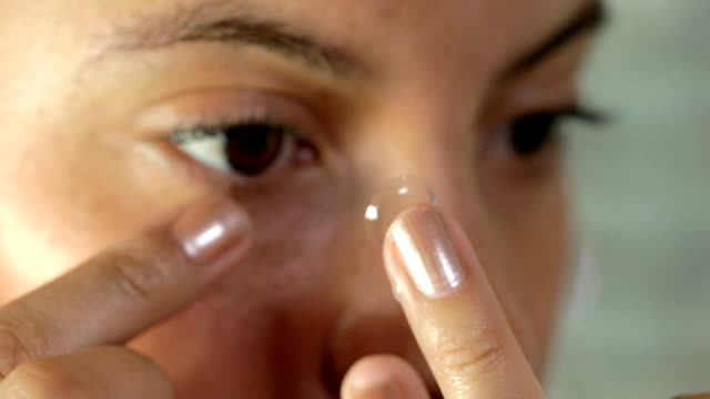 side view of contact lense into eye - inserting stock videos & royalty-free footage