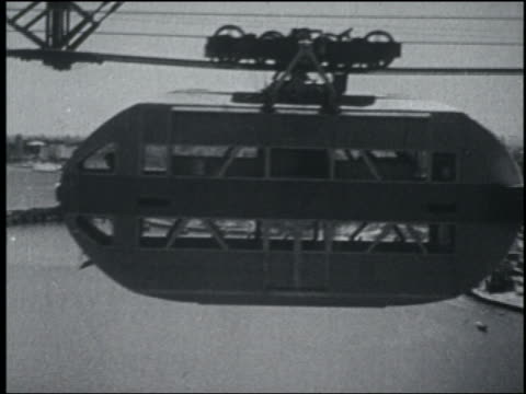 b/w 1933 side view of double decker cable car moving past camera / chicago world's fair - chicago world's fair stock videos and b-roll footage