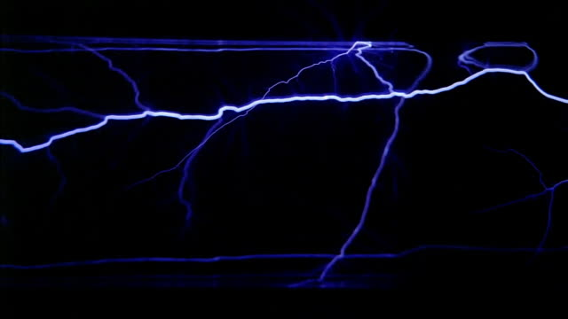 side view of electricity flowing through a clear tube - high voltage stock videos & royalty-free footage
