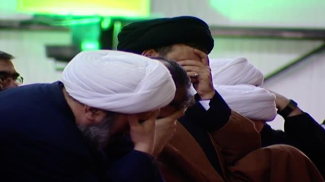 side view of hassan nasrallah, secretary-general of hezbollah, mourning at the ashura commemoration organised by hezbollah in dahieh. - シャイフ点の映像素材/bロール
