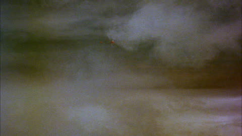 ms zi side view of jet airplane in flight through clouds  - 1959 stock videos & royalty-free footage