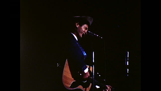 side view of man singing on stage behind the microphone while playing guitar; man with shiny blue straps singing on stage behind the microphone while... - 1960 1969 stock videos & royalty-free footage