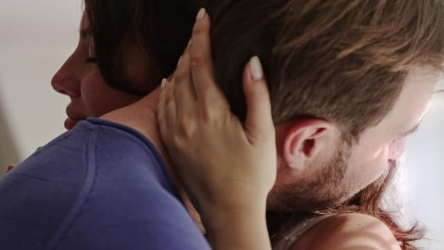 side view of married couple sharing affectionate embrace and enjoying every moment of it - ambientazione interna video stock e b–roll