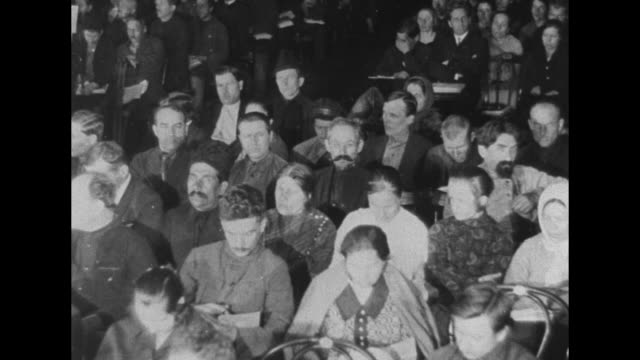 vidéos et rushes de side view of members of central executive committee sitting at long table / two shots of delegates from countries within soviet union sitting in... - groupe organisé