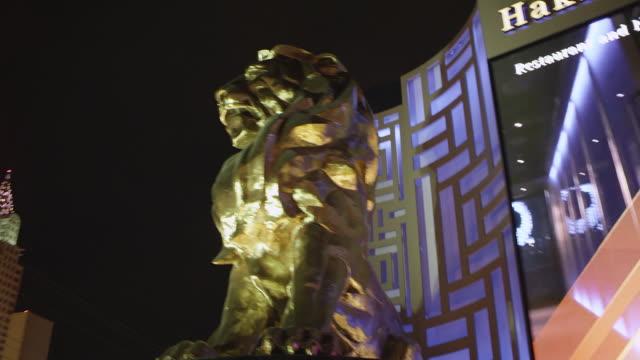 WS LA TS Side POV View of MGM Lion Statue / Las Vegas, Nevada, United States