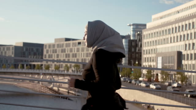 side view of muslim woman in hijab running in the sunset (slow motion) - hijab stock videos & royalty-free footage