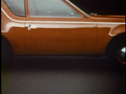 stockvideo's en b-roll-footage met cu zo side view of orange amc gremlin/ usa - 1977