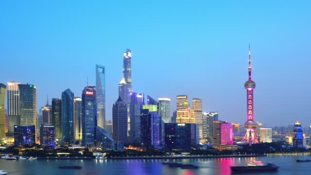 4k: side view of shanghai cityscape at sunset to night time lapse, china - sunset to night time lapse stock videos & royalty-free footage