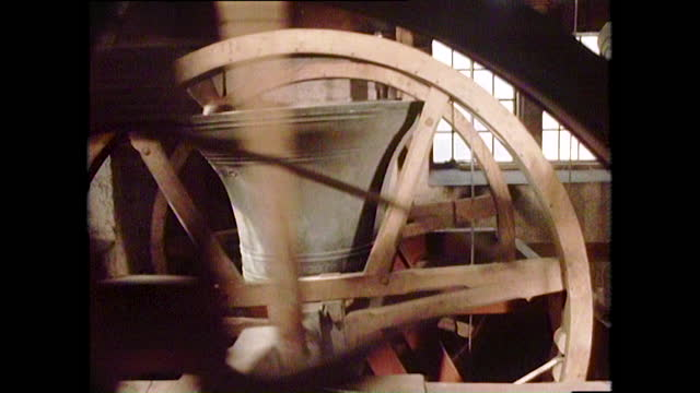 side view of the bells of st clement dane church chiming, london; 1981. - fantasy stock videos & royalty-free footage