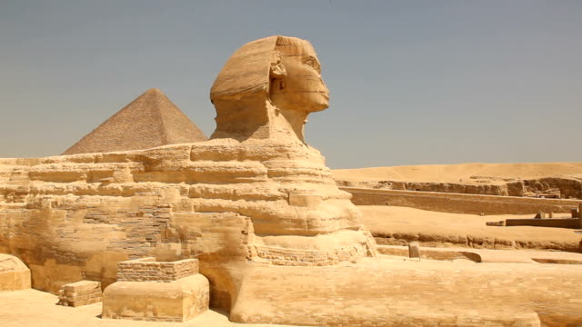 ms pan side view of the great sphinx at the pyramids of giza/ cairo / egypt - pyramid stock videos and b-roll footage