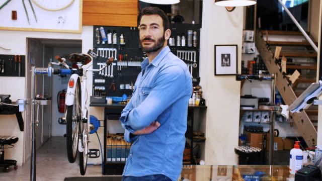 side view portrait of entrepreneur in bicycle workshop - pride stock videos & royalty-free footage