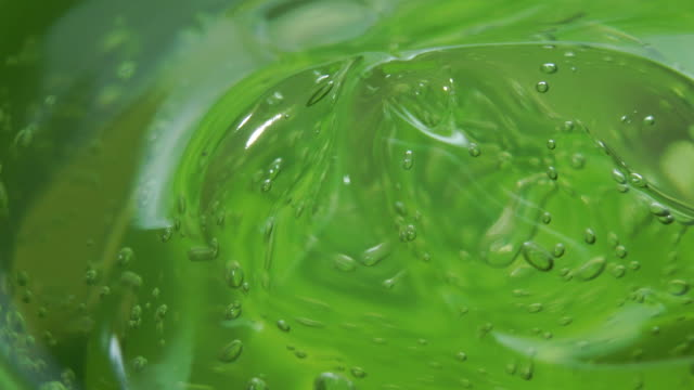 side view rotation of aloe vera gel moisturizer texture close up shot - care stock videos & royalty-free footage