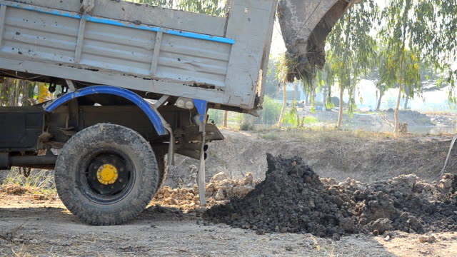 side view : truck pull soil out - dump truck stock videos and b-roll footage