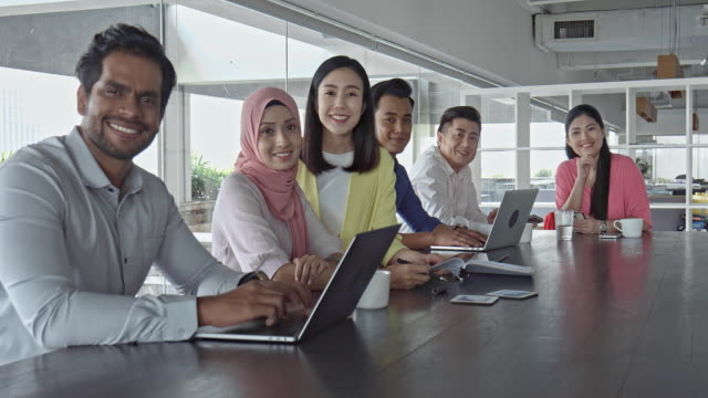 side view video of asian business people working with laptops in office - malaysia stock videos & royalty-free footage