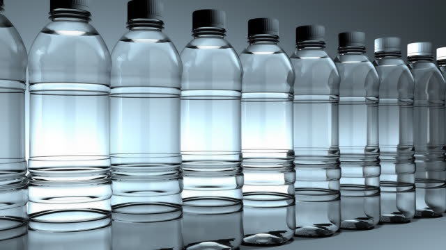 side view, water bottles slowly moving (loop) - bottle stock videos & royalty-free footage