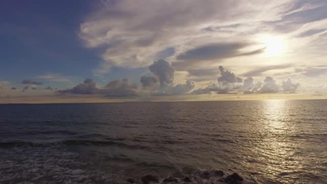 Side POV, Walking on sidewalk by the ocean.