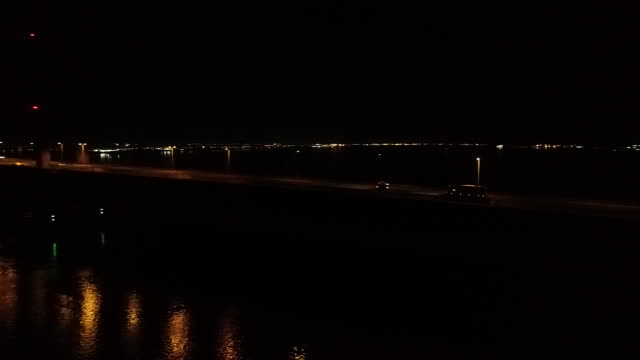 side-on panning shot of the humber bridge at night - hull stock videos & royalty-free footage