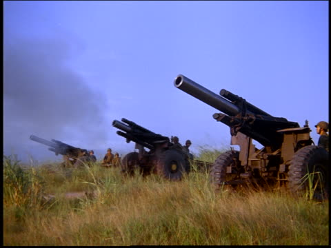 sideview of army soldiers with cannons in field shooting / rio de janeiro, brazil - artiglieria video stock e b–roll