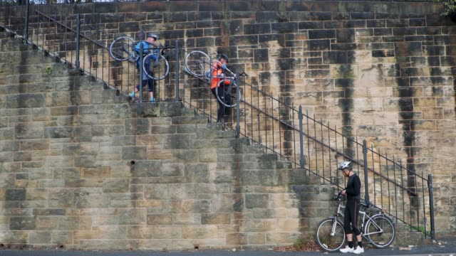 Side-View of Cyclists Down Steps
