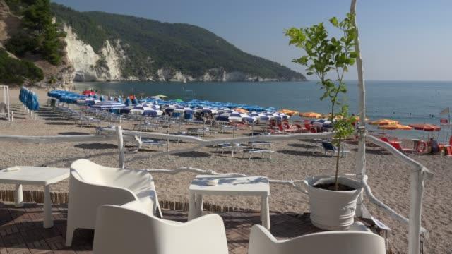 sidewalk cafe on vignanotica beach at the adriatic sea - adriatic sea stock videos & royalty-free footage