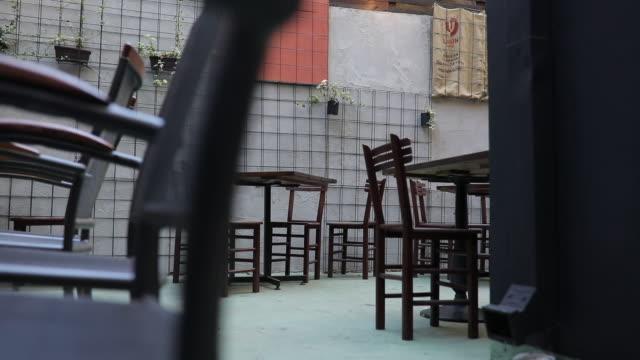 vídeos y material grabado en eventos de stock de café de la acera - terraza