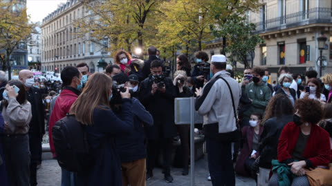 vidéos et rushes de sidhoum rezza nabil 49 years an imam independent attends to pay his respect as people gather on the place de la sorbonne to watch a live broadcast on... - respect