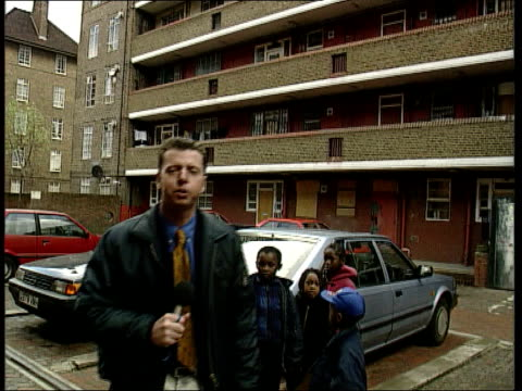 east london housing estate where jason swift lived pan to i/c - イーストロンドン点の映像素材/bロール