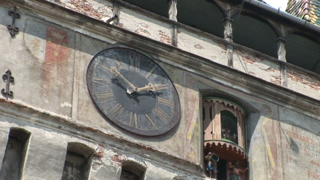 sighisoaraa big old clock sighisoara transylvania romania - clock tower stock videos & royalty-free footage