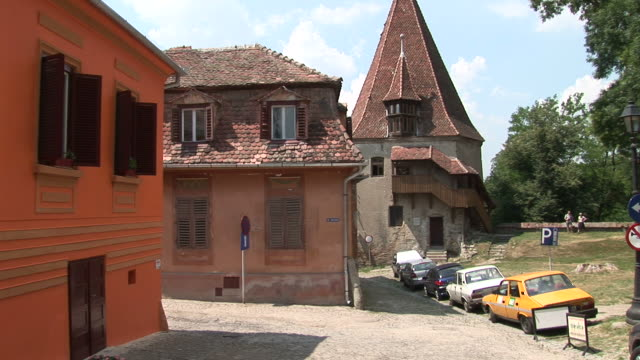 sighisoaracars parking side of the road sighisoara transylvania romania - sighişoara video stock e b–roll