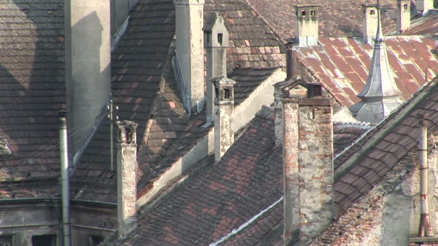 stockvideo's en b-roll-footage met sighisoaraclose view of old buildings tiled roof top sighisoara transylvania romania - târgu mureș